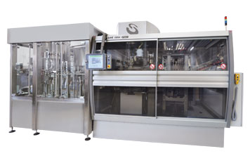 Integrated systems of stretch-blow moulding, filling and capping for carbonated liquids